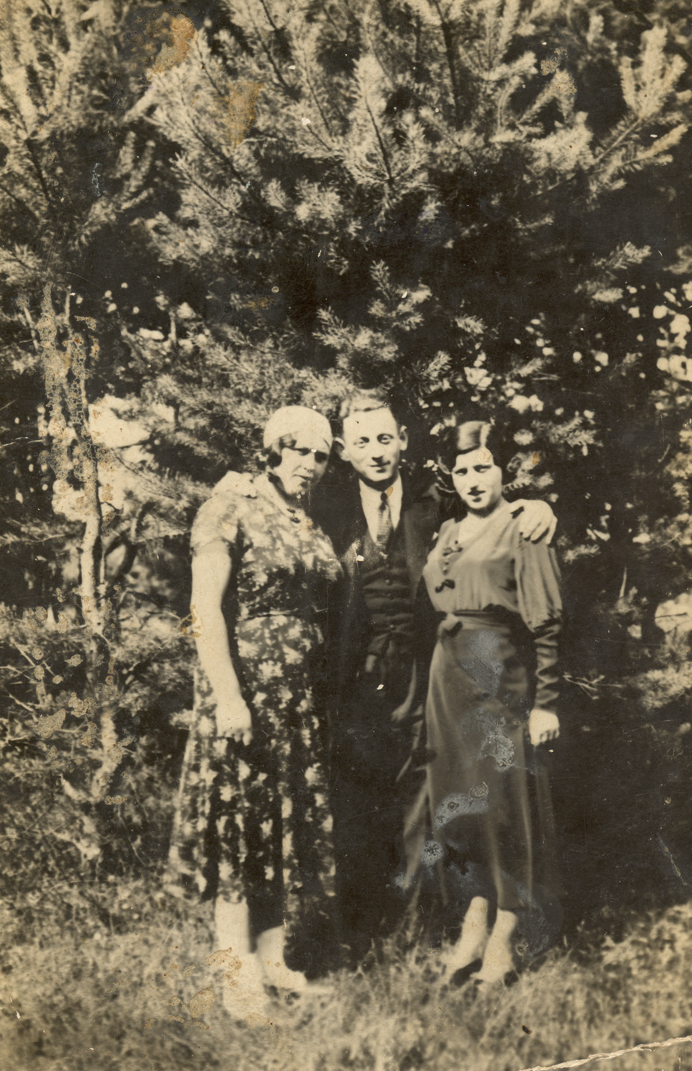 Berl Plager with his wife Beile Plager and their friend
