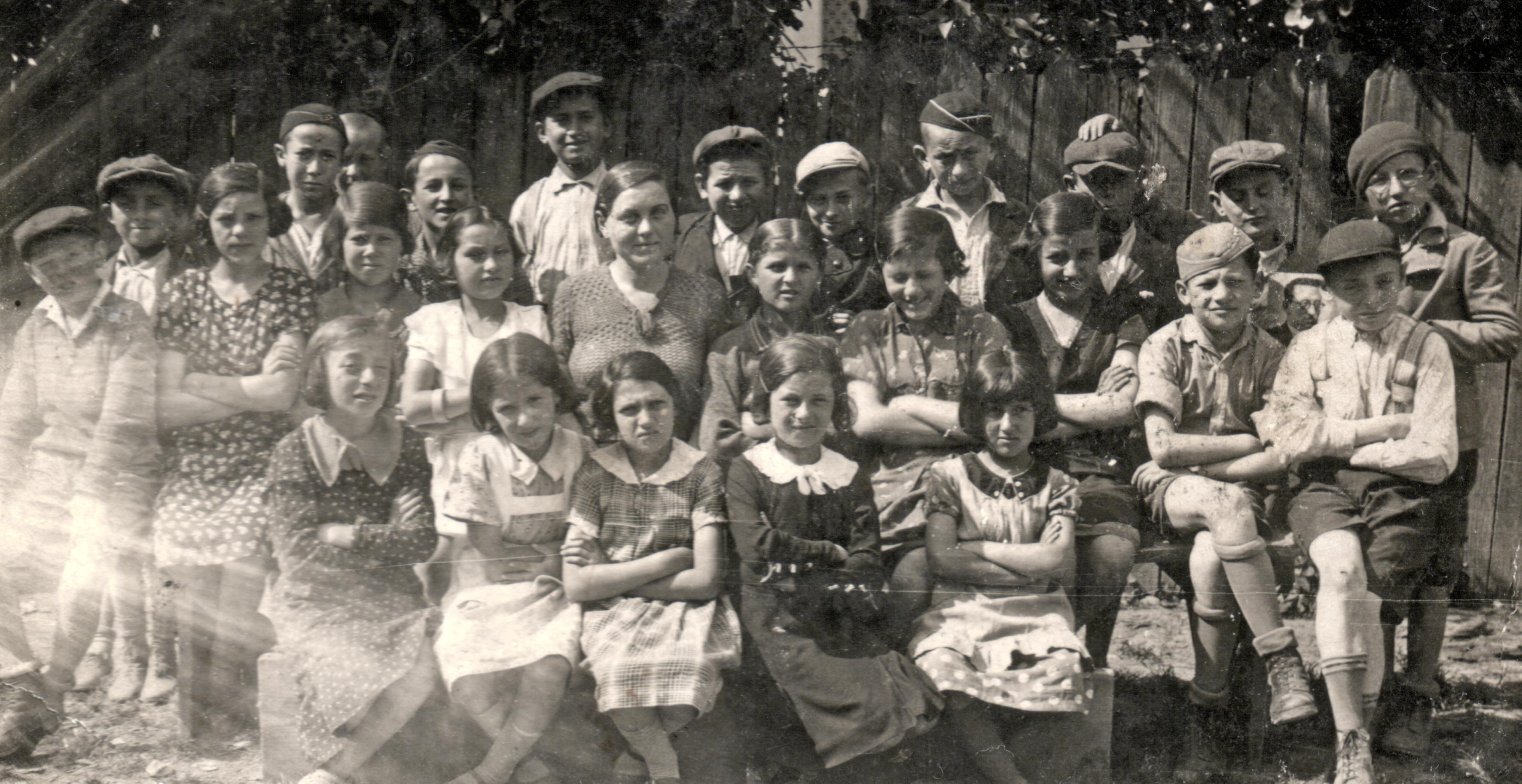 Ernest Galpert with his schoolmates and tutor Chaya Moshkovich