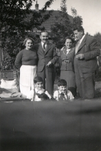 Harry Fink and his parents with friends of the family