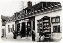 Lilli Tauber's uncle Isidor Friedmann in front of his shop in Prein
